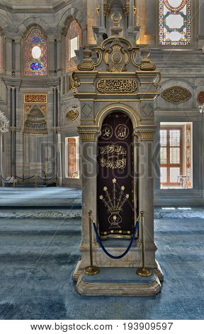 Istanbul, Turkey - April 20, 2017: White marble floral golden ornate minbar (Platform) and niche (Mihrab), Nuruosmaniye Mosque