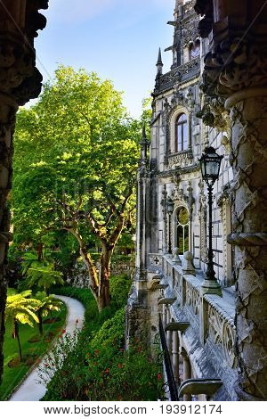 SINTRA, PORTUGAL - JUNE 6 2017: Palace Quinta da Regaleira Sintra Portugal. Palace with symbols related to alchemy Masonry the Knights Templar and the Rosicrucians shown at sunset. Masterpiece of Neo-Manueline architecture style