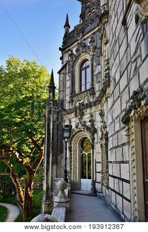 SINTRA, PORTUGAL - JUNE 10 2017: Palace Quinta da Regaleira Sintra Portugal. Palace with symbols related to alchemy Masonry the Knights Templar and the Rosicrucians shown at sunset. Masterpiece of Neo-Manueline architecture style