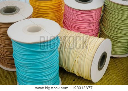 Colorful thread. Large coils with colored thread