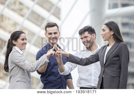 Businesspeople Showing Hand Together With Happy Emotion At Outdoor Place, Business Teamwork Concept.