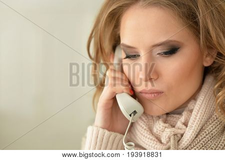 Portrait of sad  young woman with the phone