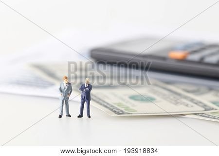 Miniature Model Group Of Investor Standing Together Isolated On White Background.