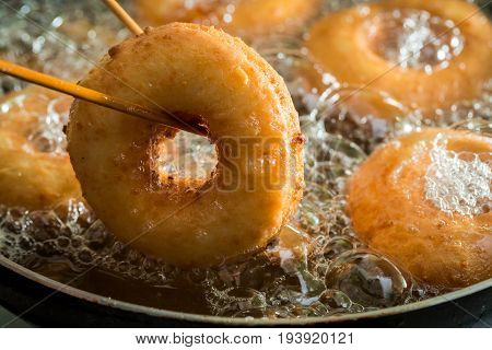 Frying Homemade And Sweet Donuts On Fresh Oil
