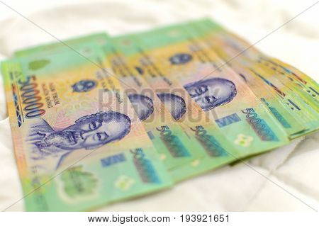 Vietnamese money 500000 Dong banknote VND with portrait of President Ho Chi Minh close-up.
