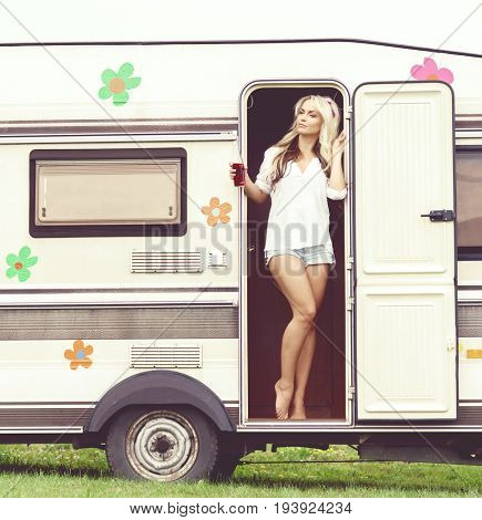 Young, attractive hippy girl standing in trailer