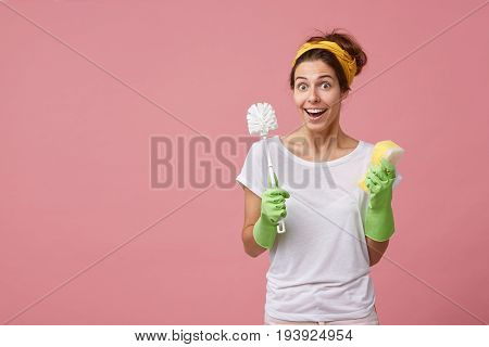 Pretty Girl In Feeling Shocked With Unexpected News While Doing Overall Cleaning Up, Wearing Rubber