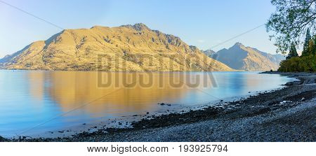 Panoramic serenity of beautiful Lake Wakatipu in the morning in Autumn Queenstown South Island of New Zealand