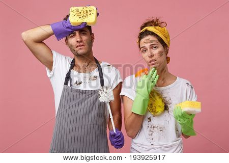 Couple Being Tired After Hard Work About House, Cleaning Everything Looking With Exhausted Looks Int