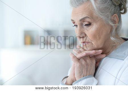 Portrait of a beautiful sad elderly woman