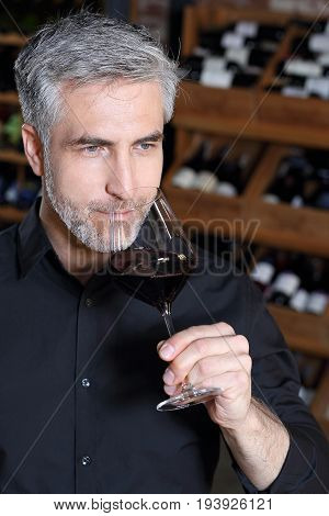 Sommelier in the restaurant evaluates the vintage