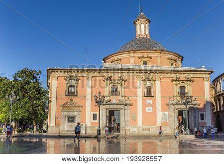 VALENCIA, SPAIN - JUNE 12, 2017: Colorful Basilica de la Virgen on the central square of Valencia, Spain