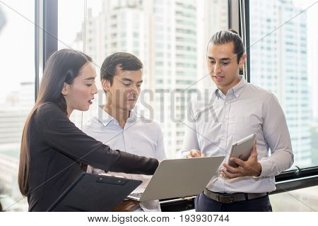 Businessman standind for present the project with team Portrait business leader concept 20-30 year old.