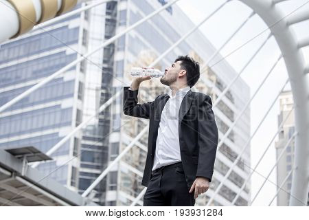 Businessman Stand And Drinking Water At City, Man Leader Concept, 20-30 Year Old.