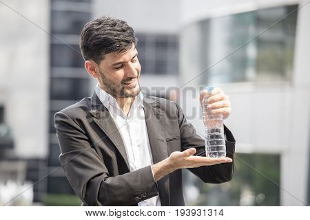 Businessman Stand And Showing Water At City, Man Leader Concept, 20-30 Year Old.
