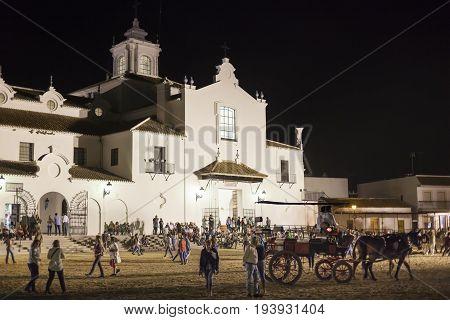 El Rocio Spain - June 4 2017: Piilgrims in front of the hermitage in El Rocio during the Romeria 2017. Province of Huelva Andalusia Spain