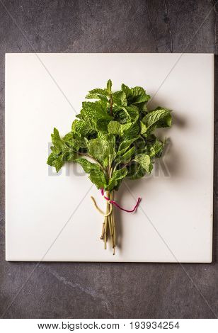 Bunch of fresh green mint leaves. An aromatic and flavorful herb.