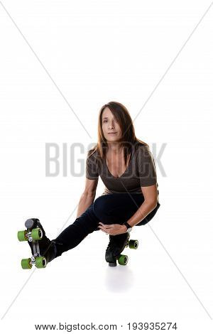 woman shooting the duck on quad roller skates