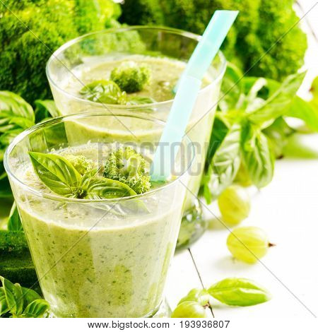 Basil broccoli frisee lettuce smoothie on green background