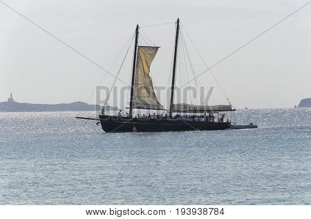 Villasimius Italy - September 28 2016: Sailing boat with tourists on board approaches the coast
