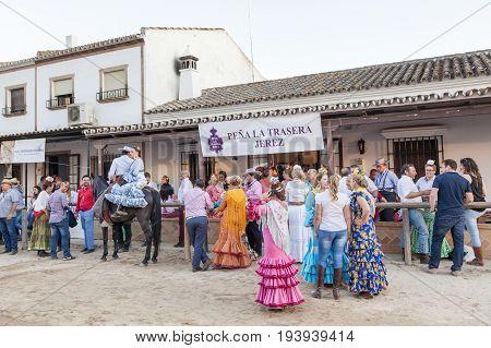 El Rocio Spain - June 4 2017: Group of pilgrims in traditional spanish dress in El Rocio during the Romeria 2017. Province of Huelva Almonte Andalusia Spain