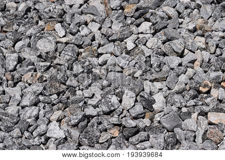 Large gravel rock stone background at construction site