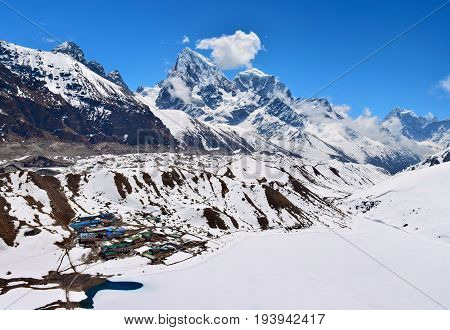 Beautiful View Of The Gokyo Village And Gokyo Lake Covered With Snow. Himalayan Mountains, Nepal.