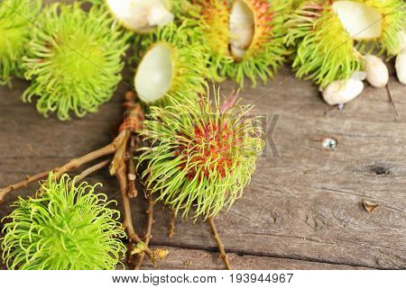 Rambutan Thai fruit on brown wood background