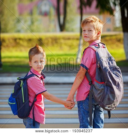 Portrait Two Adorable Boys With Backpack Near Pedestrian Crossin.