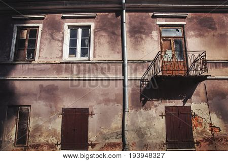 stylish background of old neglected tenement building facade