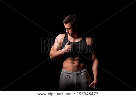 Muscular and sexy body of young man stripping