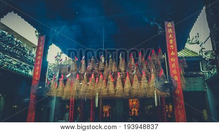 The Incense Smoke Is Slowly Lingering Inside A Chinese Temple.