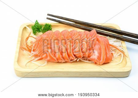 salmon sashimi on a wooden plate with wooden chopsticks isolated on white background