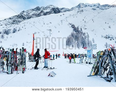 Chamonix, France - January 24, 2015: People skiing, pile of Skis and slopes view at Les Grands Montets ski area near Chamonix, France