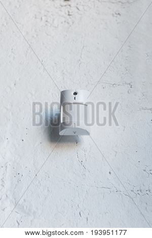 Close Up Of One White Motion Sensor On White Wall