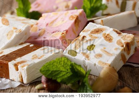 Delicious Dessert: Honey Nougat With Nuts And Mint Macro. Horizontal