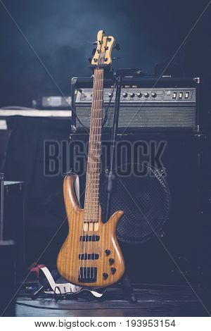 Bass guitar and sound amplifier on stage. Live concert concept