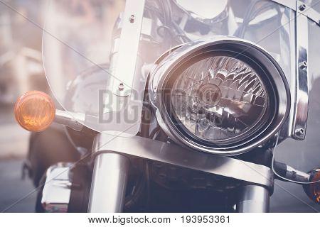 Vintage motorbike focus on a headlamp. Retro motorcycle with headlight.