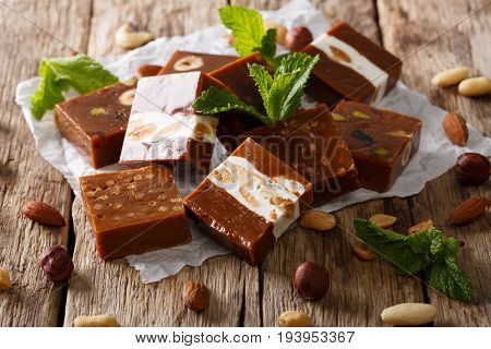Square Sweets Toffee With Nuts Decorated With Mint Closeup. Horizontal