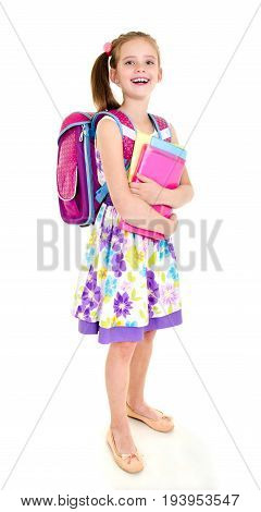 Portrait of smiling happy school girl child with backpack and books isolated on a white background