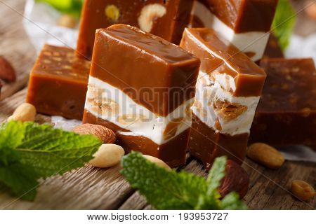 Toffee With Nougat And Almonds, Fresh Mint Macro. Horizontal