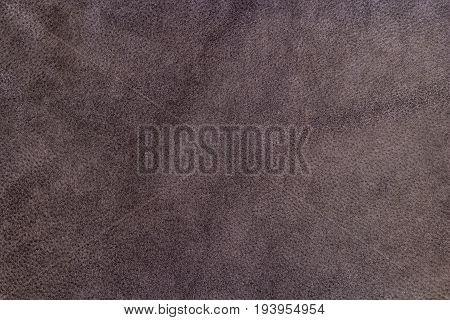 Brown red leather texture close-up, useful for background design