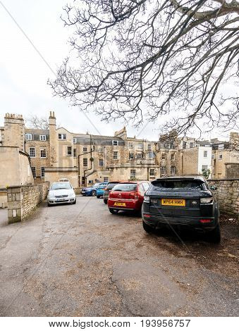 BATH UNITED KINGDOM - MAR 7 2017: Typical Bath England architecture real estate houses with cars parked in he courtyard