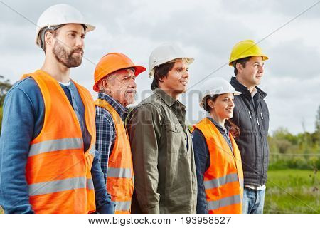 Group of construction workers standing proud and self confident