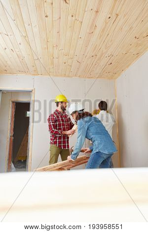 Craftsman and artisan working as team building new house