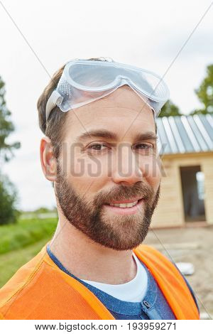 Worker with protective googles at construction site