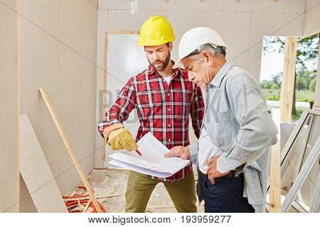 Senior craftsman as chief planning building construction with artisan