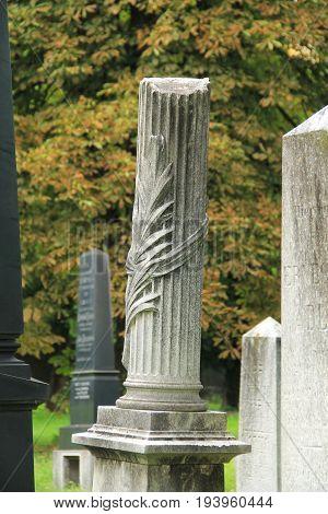 old headstone with decorative column on the jewish cemetery in Frydek-Mistek, Czech Republic, July 2, 2017