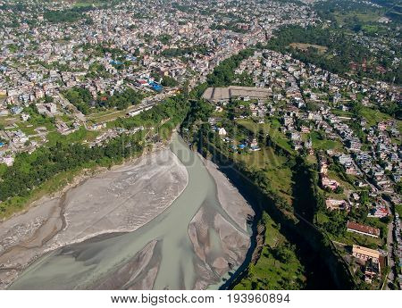 POKHARA, NEPAL. Flight on a hang glider (deltaplan). Shooting Pokhara and Seti river from the height of bird flight.