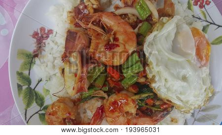 Rice with stir-fried shrimp squid and basil. thai food